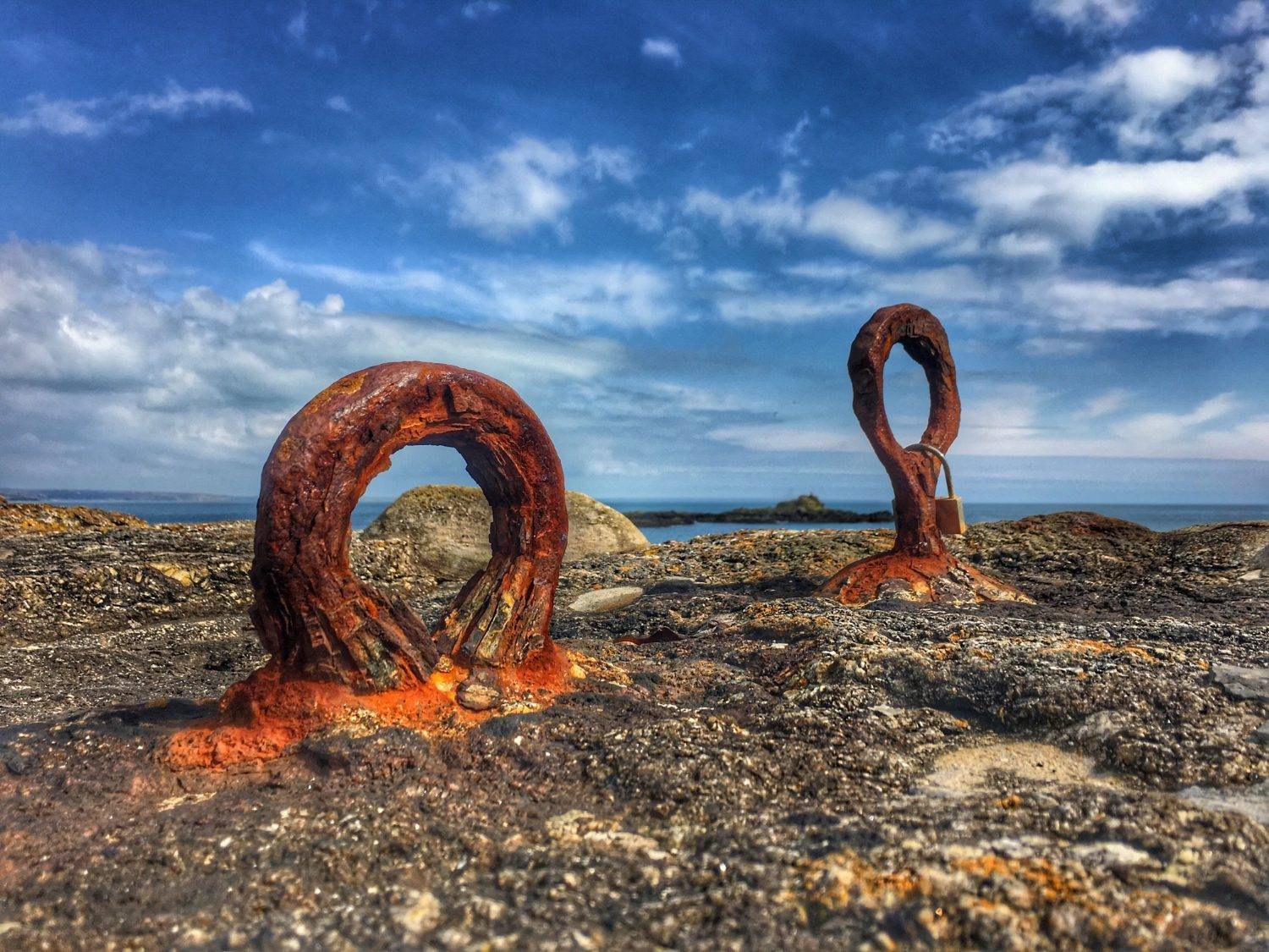Rusting iron rings on the sea wall at Mousehole Harbour