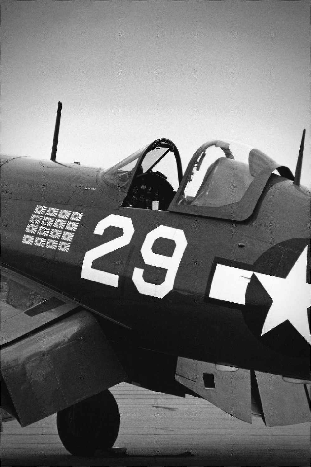 Black and white photo of a Vought F4 Corsair at Duxford