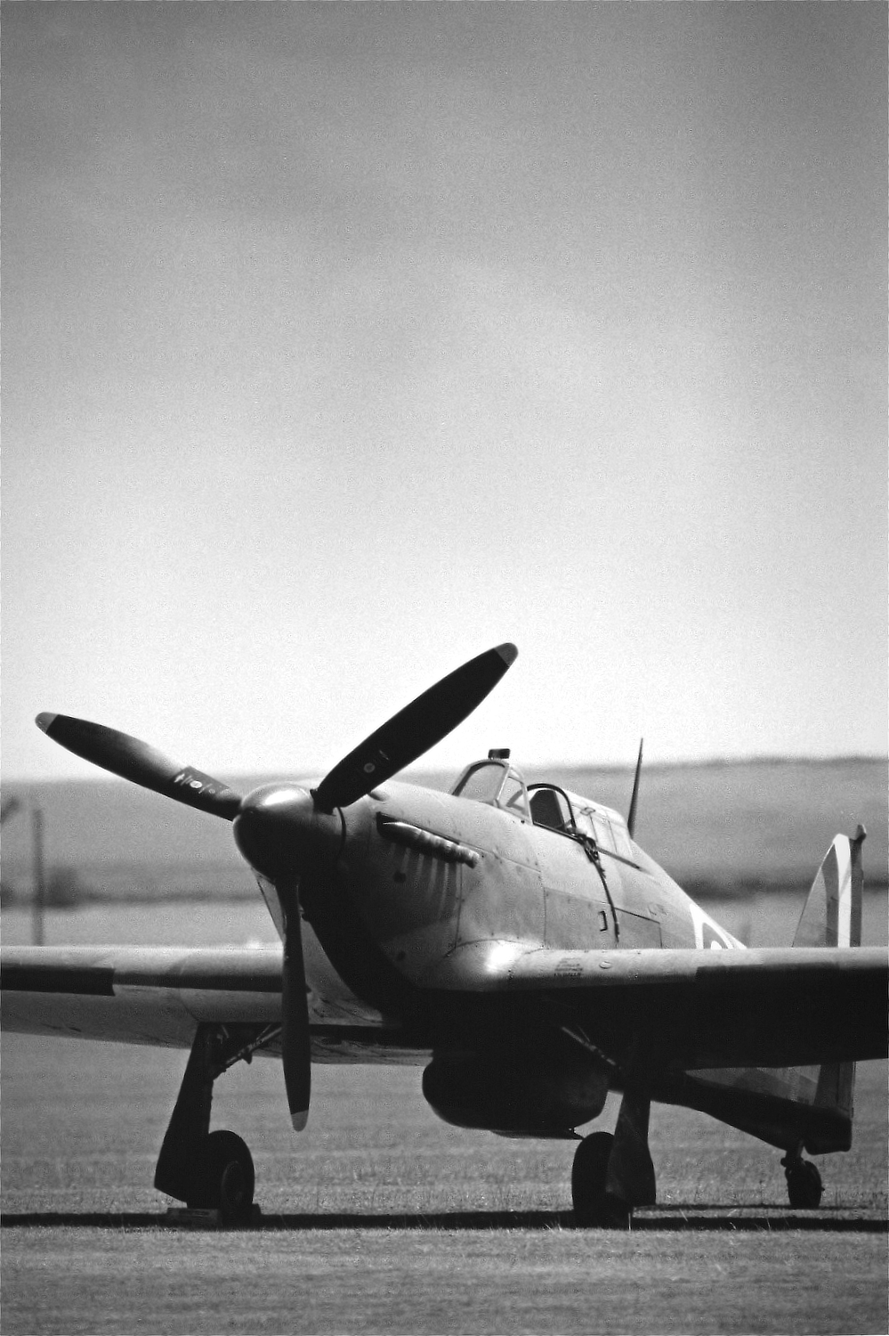 Black and white photo of a Hawker Hurricane at Duxford