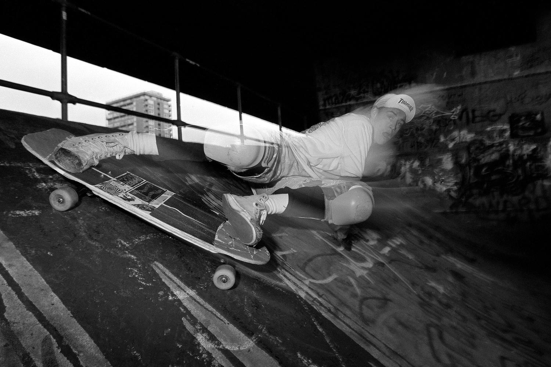 skateboarder slides on a bank